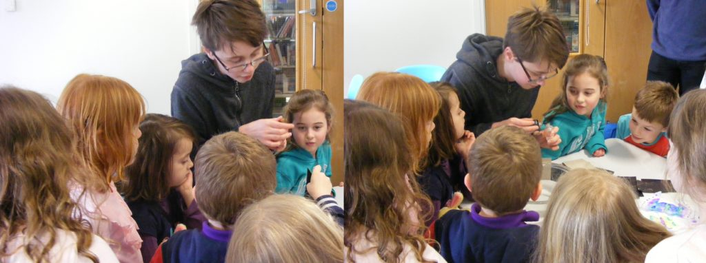 Young Scientist of the Month, Sam, showing the group how to make Rainbow paper.